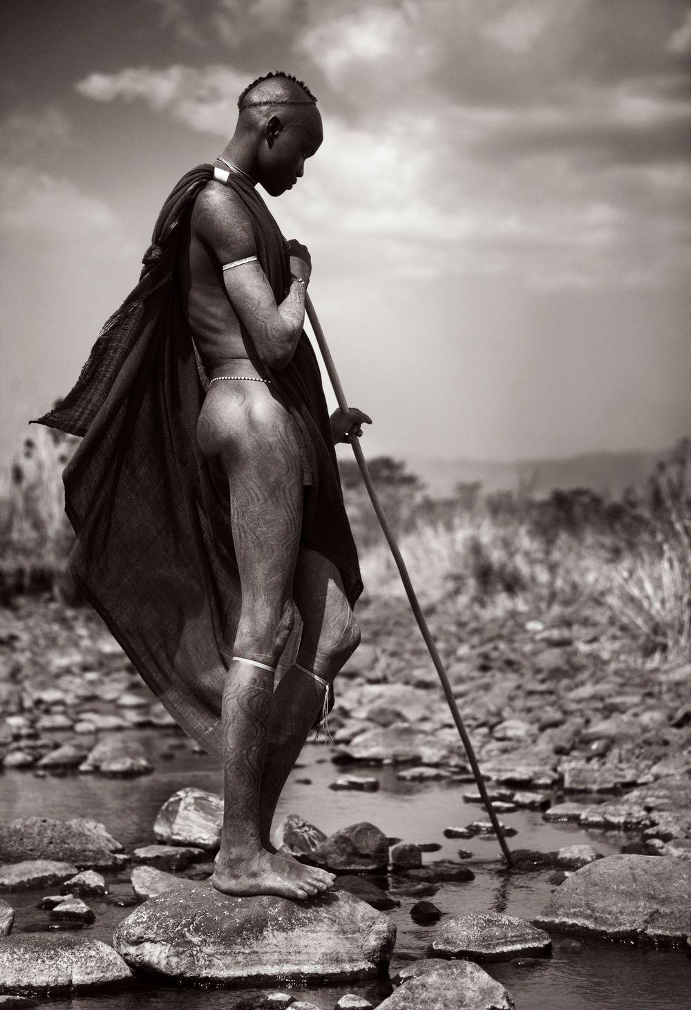 Omo-People-Drew-Doggett-africa-tribe-man-warrior-staff-river-Untitled-18.jpg