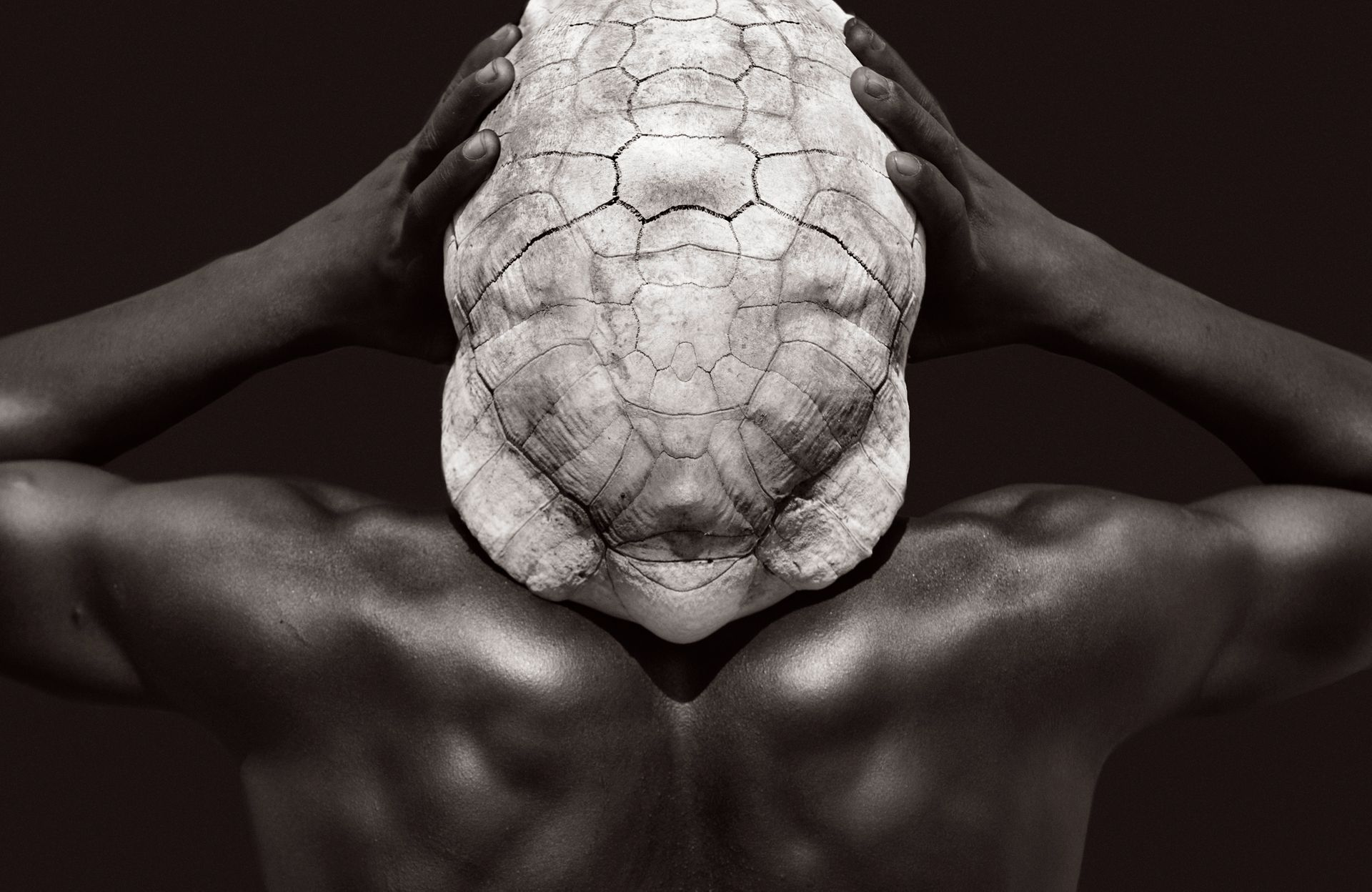 Omo-People-Drew-Doggett-africa-tribe-turtle-shell-hat-muscular-man-back-Untitled-5.jpg
