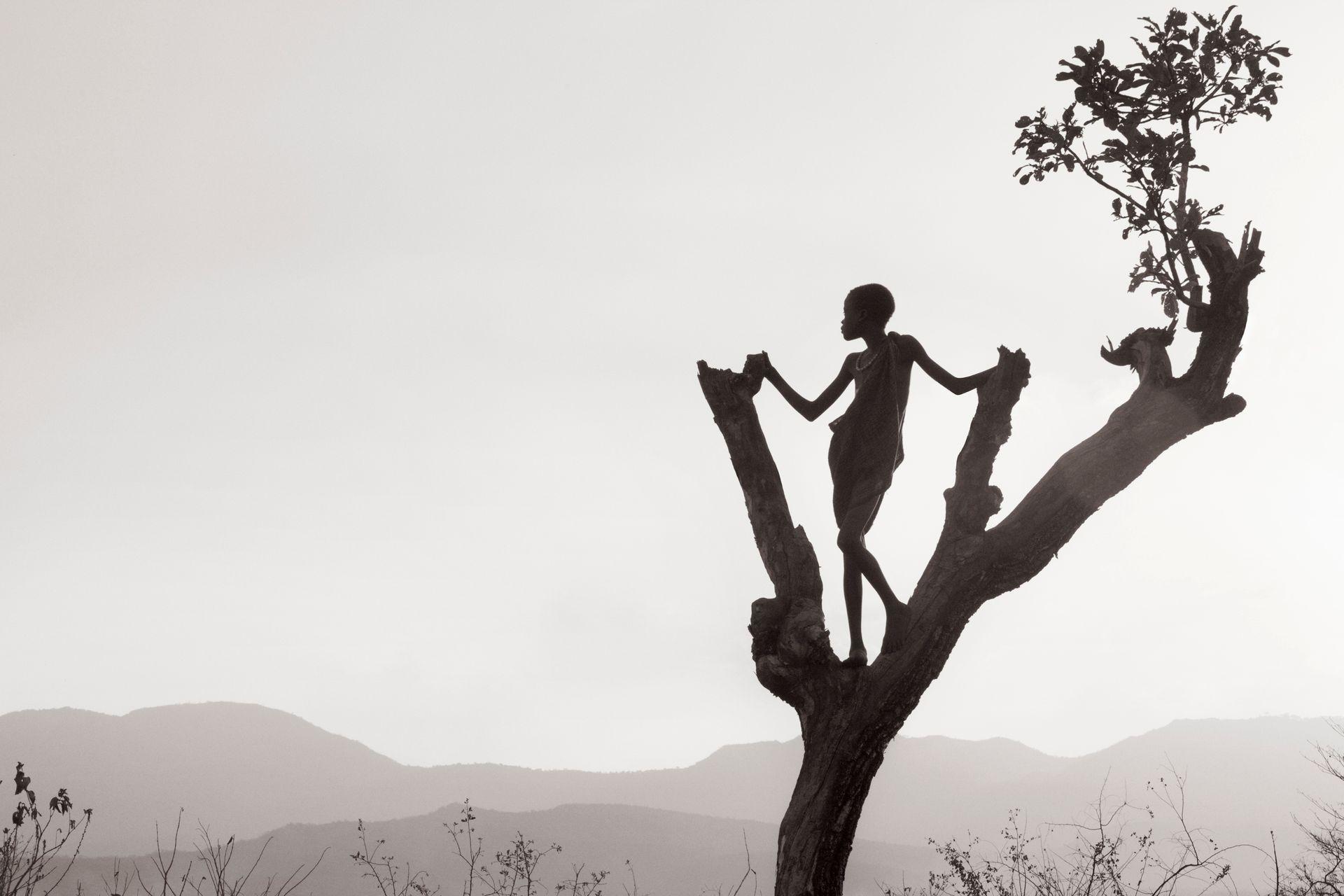 Omo-People-Drew-Doggett-africa-tribe-boy-tree-landscape-Untitled 20.jpg