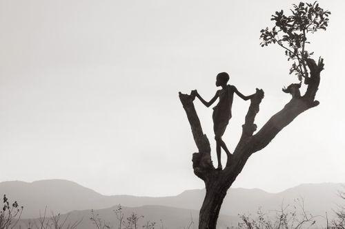 Omo-People-Drew-Doggett-africa-tribe-boy-tree-landscape-Untitled-20-1024x682.jpg